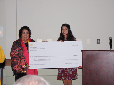 Razia receiving a check